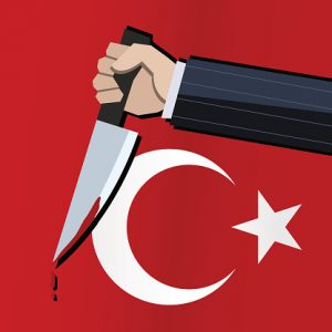 Business man holding knife in front of Turkish flag
